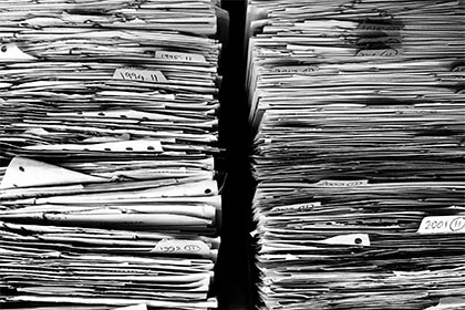 two stacks of paperwork